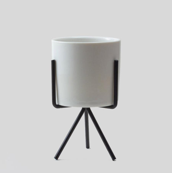 white ceramic pot with metal stand