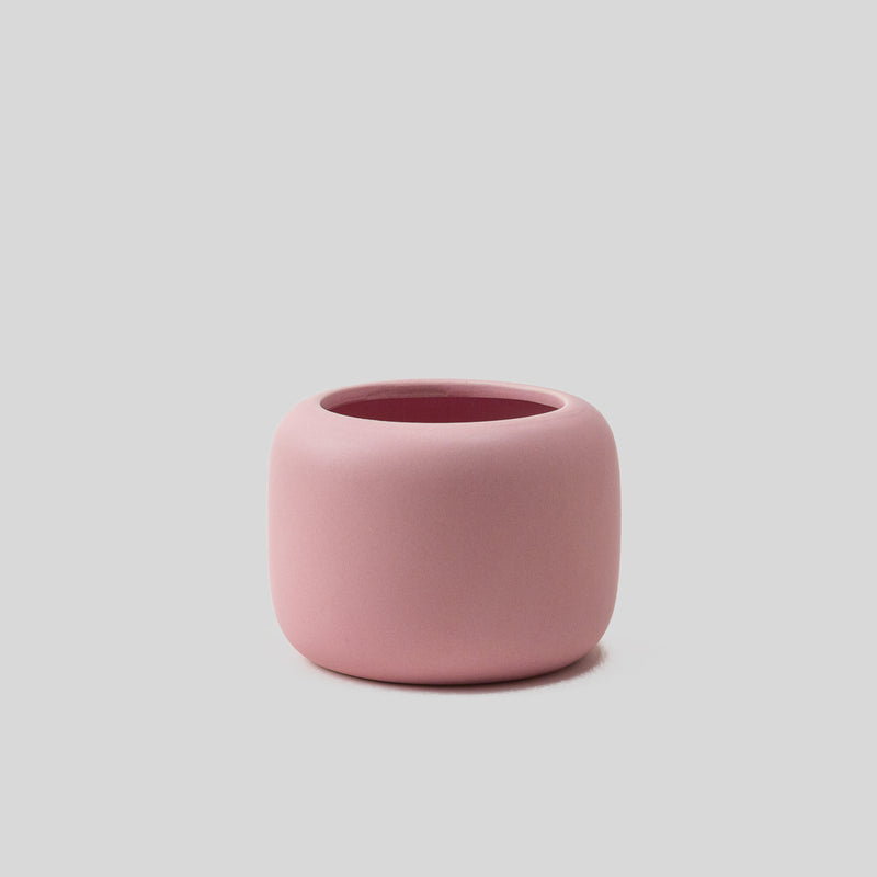 medium ceramic blush pink plant pot with matt finish, perfect for cactus or succulent arrangement with drainage hole