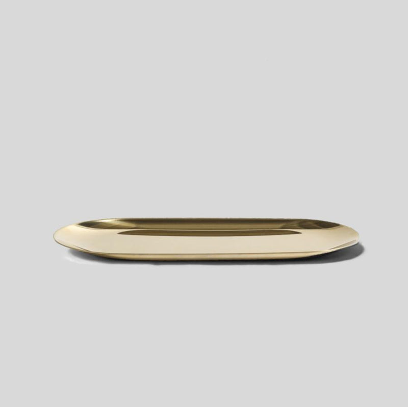 small gold oblong metal tray