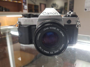 Canon AE-1 Program, 35mm Film Camera w/ 50mm F1.8 lens, Fresh CLA and working like new. - Paramount Camera & Repair - Saskatoon Canada Used Cameras Used Lenses Batteries Grips Chargers Studio