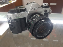 Load image into Gallery viewer, Canon AE-1 Program, 35mm Film Camera w/ 50mm F1.8 lens, Fresh CLA and working like new. - Paramount Camera & Repair - Saskatoon Canada Used Cameras Used Lenses Batteries Grips Chargers Studio