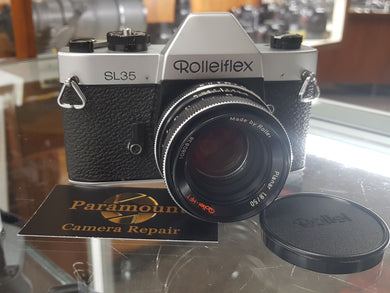 Rolleiflex SL35 35mm SLR Film Camera, CLA'd w/ Planar Rollei 50mm 1.8 HFT Lens - Paramount Camera & Repair - Saskatoon Canada Used Cameras Used Lenses Batteries Grips Chargers Studio