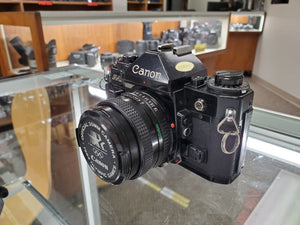 Canon A-1, Black, 35mm Film Camera w/ 50mm F1.8 lens, Fresh CLA, - Paramount Camera & Repair - Saskatoon Canada Used Cameras Used Lenses Batteries Grips Chargers Studio
