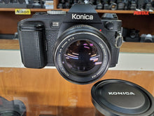 Load image into Gallery viewer, Konica FS-1, 35mm SLR Film Camera w/ 50m F1.4 Lens, Professional CLA, Canada