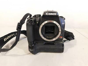 Canon Rebel XS - 10.1MP DSLR w/ Canon Grip, Batteries & Charger, Used Condition 10/10 - Paramount Camera & Repair - Saskatoon Canada Used Cameras Used Lenses Batteries Grips Chargers Studio