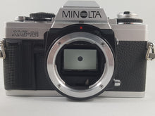 Load image into Gallery viewer, Minolta XG-M, 35mm Film Camera w/ 135mm 2.8 Lens - Paramount Camera & Repair - Saskatoon Canada Used Cameras Used Lenses Batteries Grips Chargers Studio