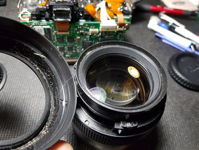 Lens Cleaning - Internal - Paramount Camera & Repair - Saskatoon Canada Used Cameras Used Lenses Batteries Grips Chargers Studio
