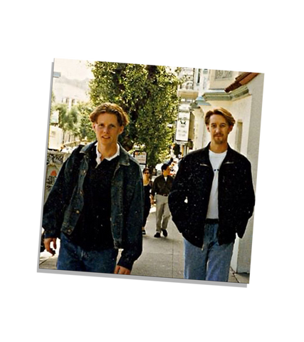 Nate Rasmussen and David Stegmeier walking together on a tree lined street in San Francisco, California