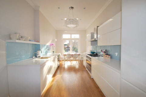 Galley kitchen blue splashback and white kitchen