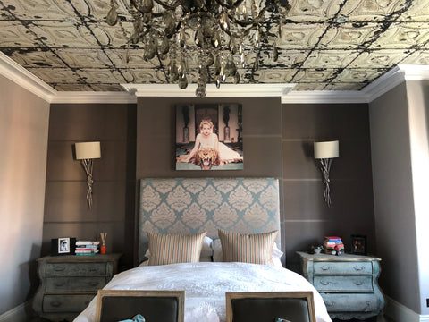 Fleur ward interior design bedroom with wallpapered ceiling chandelier and two large bedside drawers