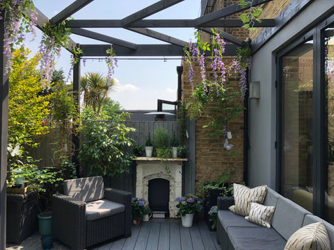 outdoor fireplace and patio by fleur ward interior design