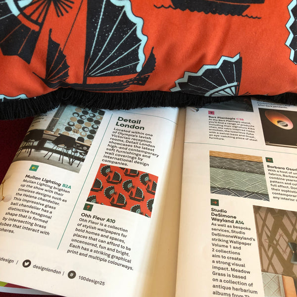ohh fleur at 100% design kensington olympia designer wallpaper and fabrics  Fan of Junk in red getting some press in the show guide