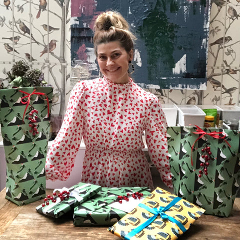 fleur ward surrounded by gifts she's wrapped in her off piste wrapping paper