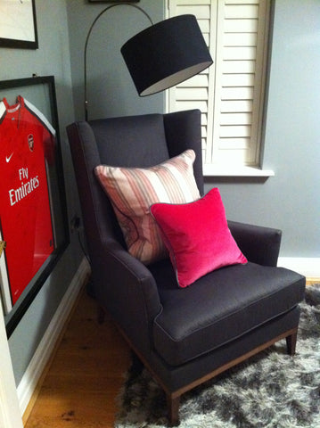 office with treasured items framed, comfy chair and punchy pink cushions