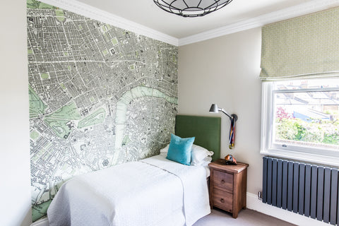 boys bedroom with green map mural green headboard