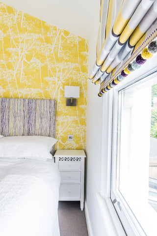 spare aupair room design yellow and lilac triangular shaped room romo small spaces