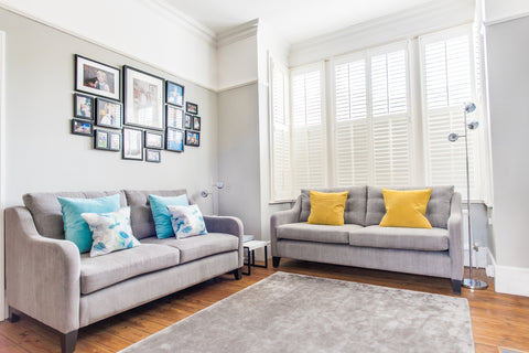 Fleur ward interior design grey sofas yellow and teal cushions