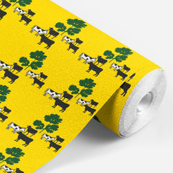 roll of yellow wallpaper with black and white cows standing around some green parsley