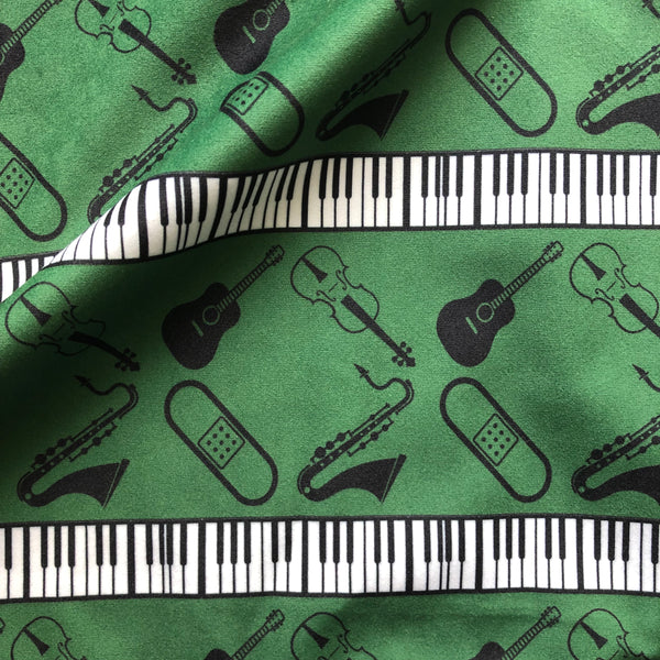Band Aide Designer Fabric blue velvet with piano keys, sa, guitar and violin on it