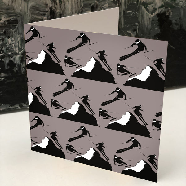 Off Piste greeting card in taupe with skiers coming down a mountain in black