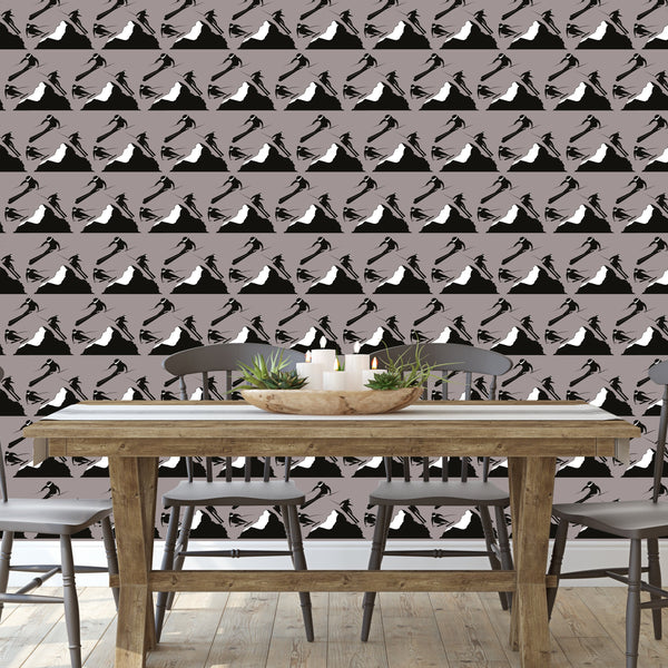 Dining room with black and white skiers on mocha wallpaper on wallpaper