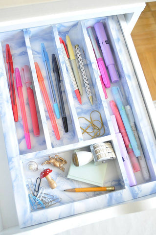 DIY Marbled Organizer Tutorial from Design Sponge on the Laura James Jewelry Blog!