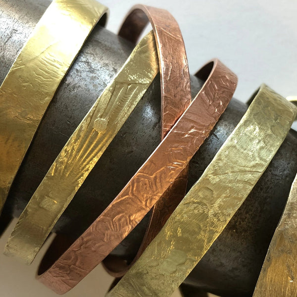 Forged Metal Bangle Bracelets by Laura James Jewelry in North Carolina