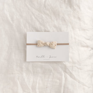 knot bow - cream eyelet