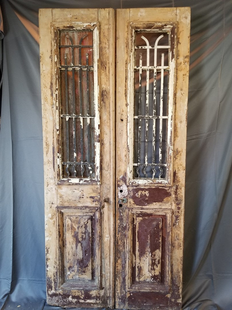 PAIR OF RUSTIC PAINTED DOORS WITH IRON INSERTS