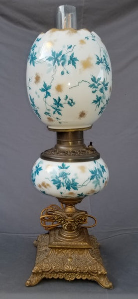 SMALL CONVERTED OIL LAMP WITH BLUE, YELLOW AND WHITE EGG SHAPED FLORAL SHADE