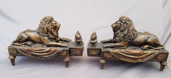 PAIR OF SMALL BRONZE LION ANDIRONS