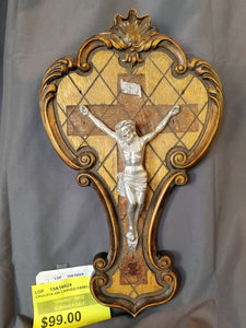 WHITE METAL CRUCIFIX ON WOOD CARVED PANEL