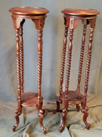 PAIR OF INDONESIAN MAHOGANY PLANT STANDS with 4 twist columns
