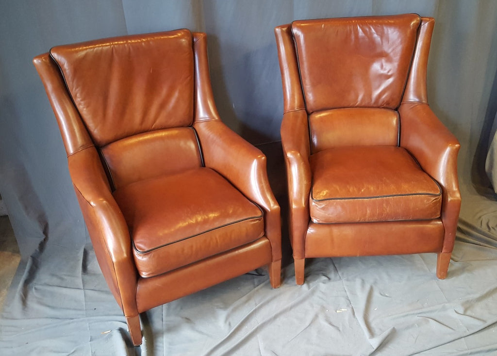 PAIR OF ENGLISH LEATHER CHAIRS AND OTTOMAN
