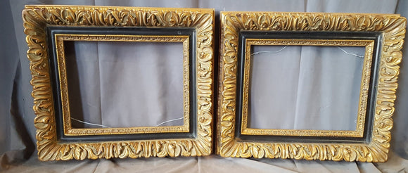 PAIR OF GOLD AND BLACK WOOD AND COMPOSITION FRAMES