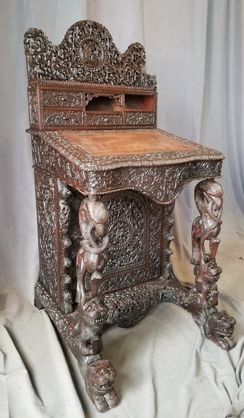 CARVED BURMESE DAVENPORT DESK