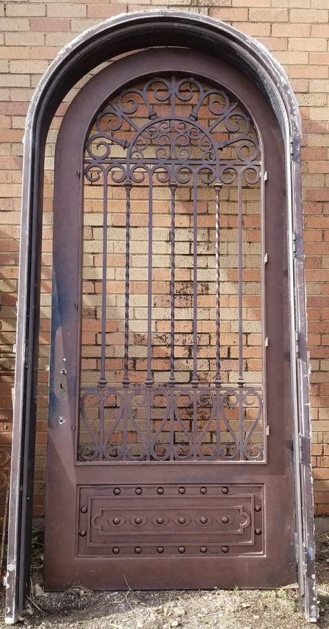 HUGE IRON ARCHED DOOR W/ DOOR FRAME