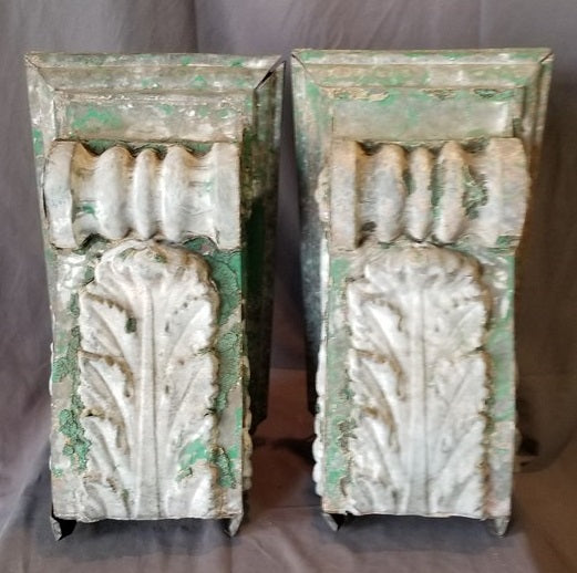 PAIR OF ZINC PAINTED GREEN AND WHITE CORBELS