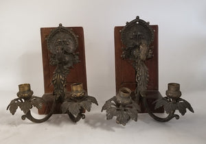 PAIR OF ORNATE DOUBLE ARM IRON WALL SCONCES WITH DARK PATINA