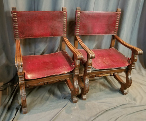 PAIR OF SPANISH ARM CHAIRS WITH LEATHER SEATS AND BACKS