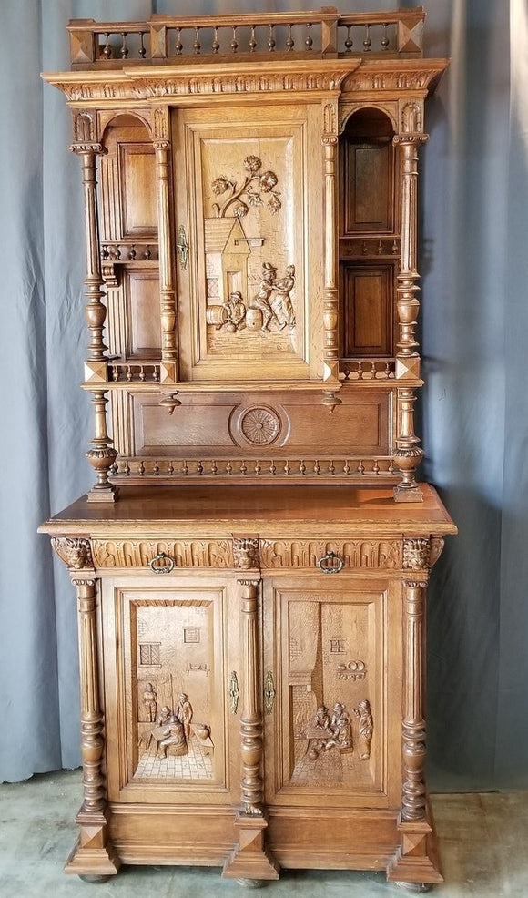FRENCH OAK BUFFET WITH CARVED DRINKING FOLKS
