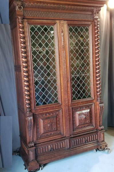 TALL OAK BARLEY TWIST LEADED GLASS DOORS BOOKCASE WITH LIONS