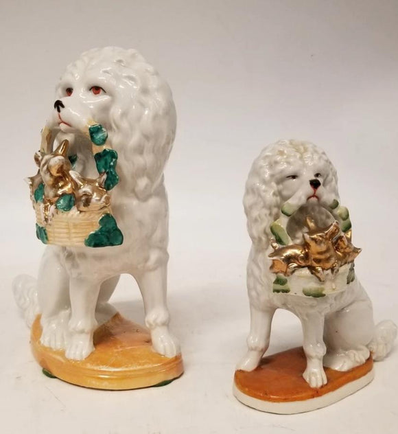 PAIR OF POODLE DOGS HOLDING BASKETS