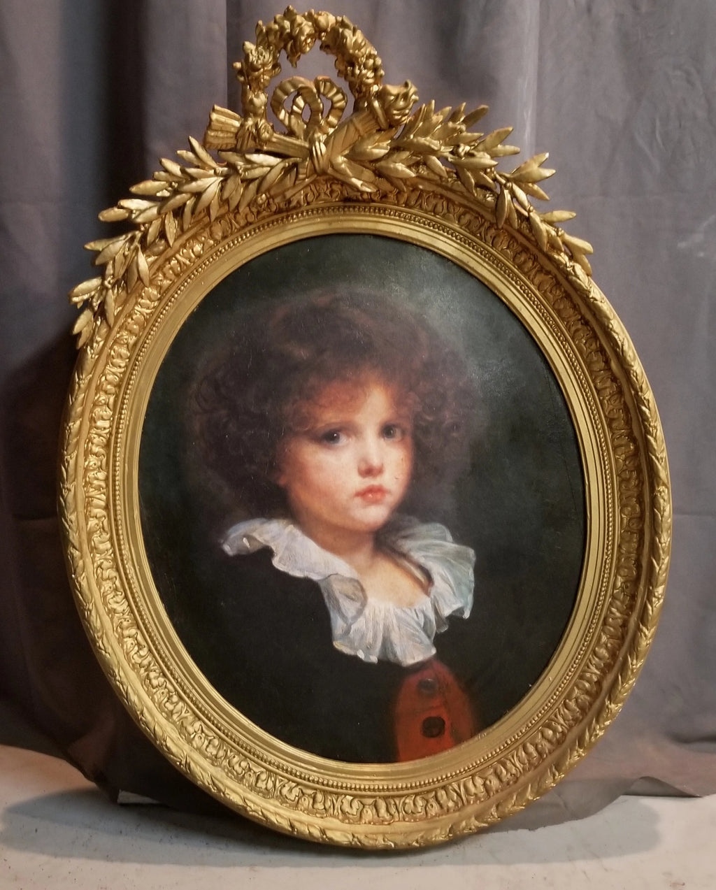 LARGE LOUIS XVI  GOLD OVAL FRAME WITH CHILD PRINT