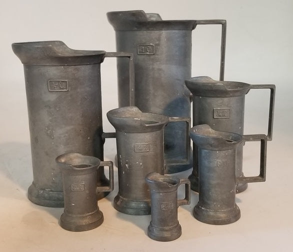 SET OF 7 GRADUATED PEWTER MEASURES