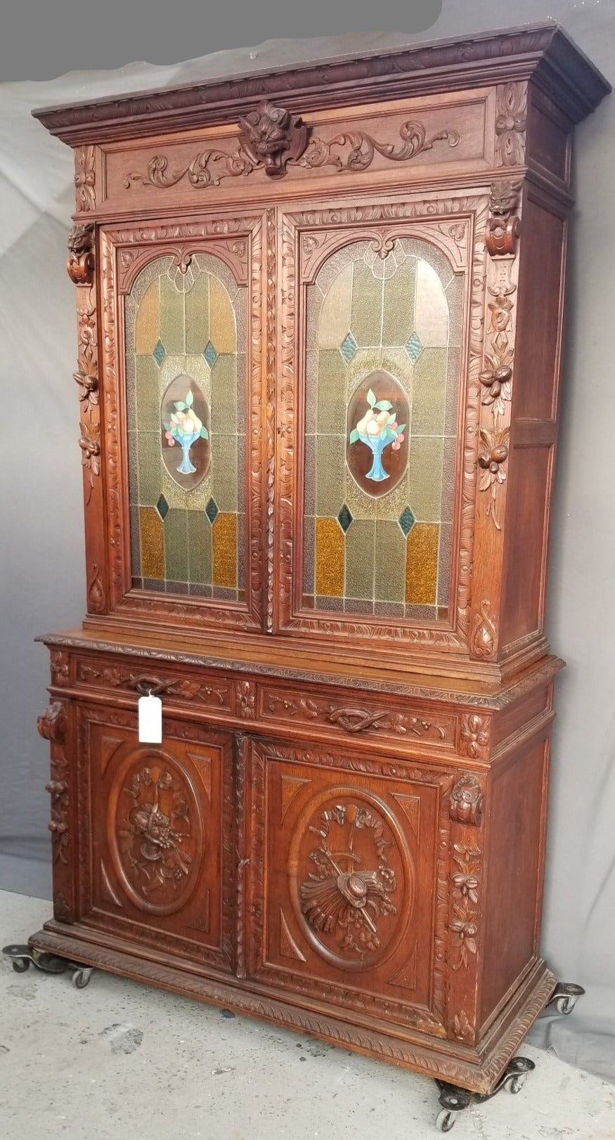 NEO RENAISSANCE LION HEAD OAK BOOKCASE WITH FRUIT STAINED GLASS DOORS