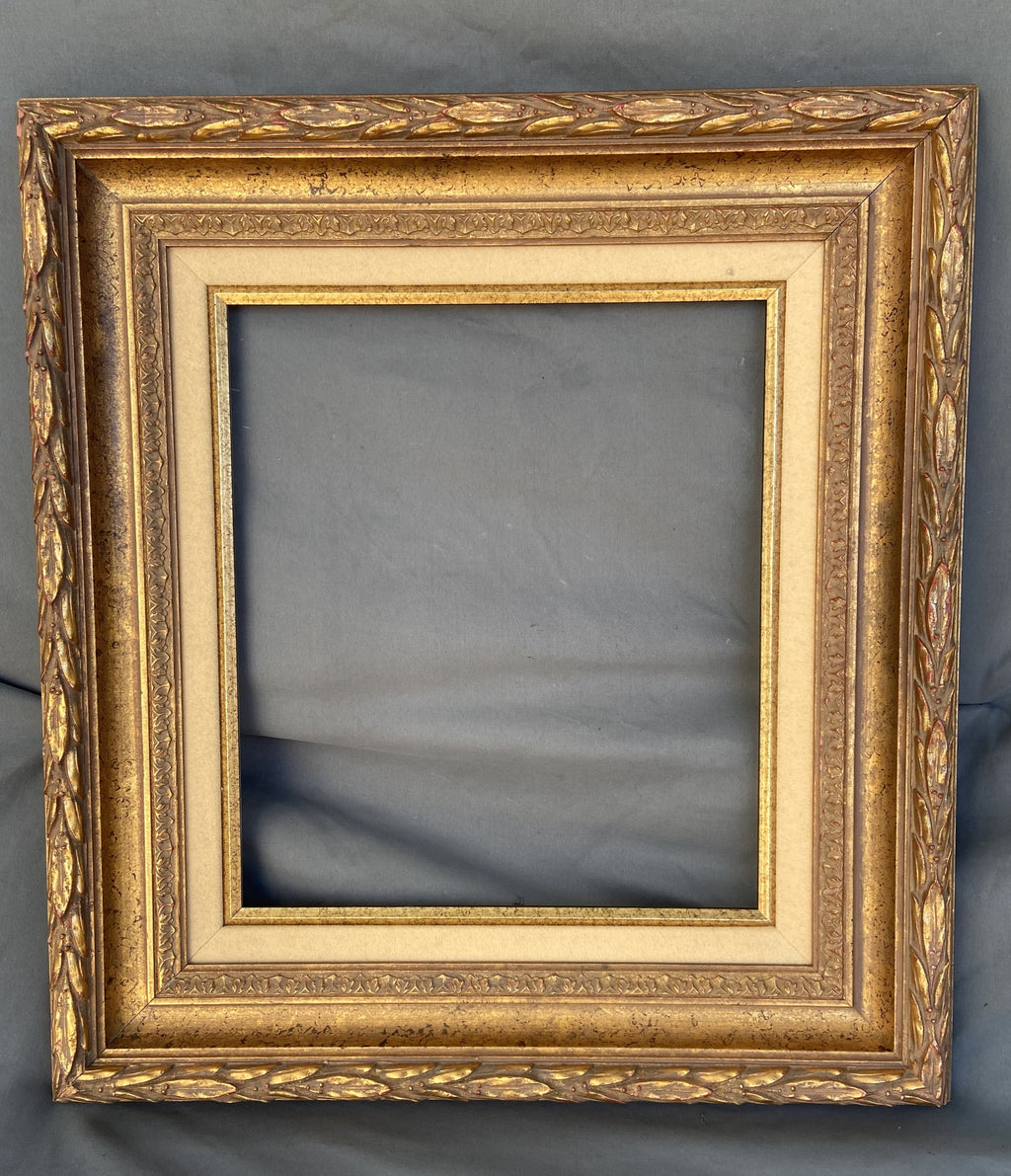 GOLD FRAME WITH OUTER LAURELING AND LINEN LINER