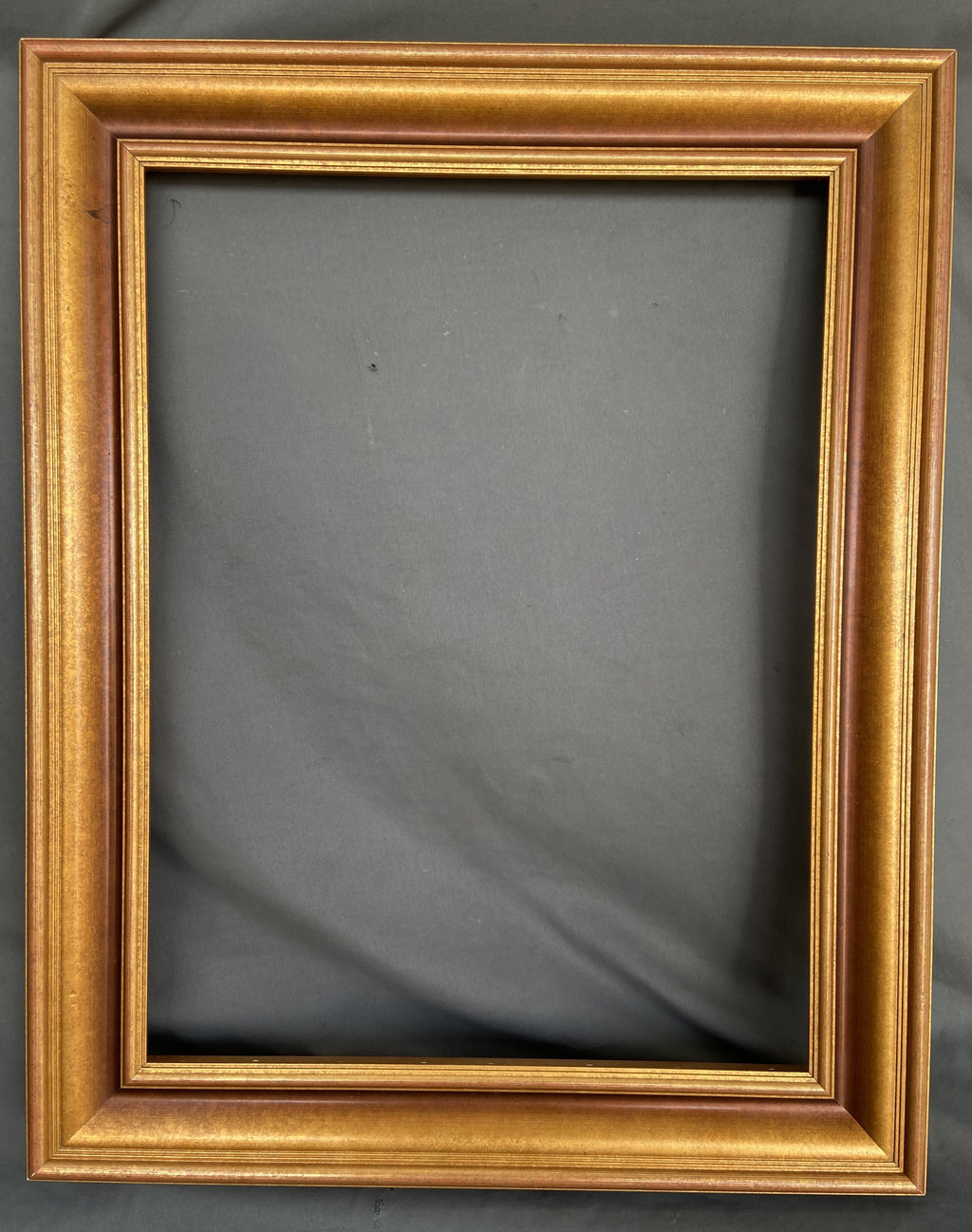 GOLD FRAME WITH SLIGHT RED COLORING