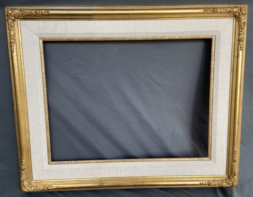 GOLD FRAME WITH ORNATE CORNERS AND LINEN LINER
