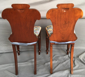 PAIR OF ENGLISH MAHOGANY HALL CHAIRS WITH UNICORN CUSHIONS